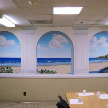Hand Painted Sand Castle Mural by Artist Bonnie Lee Turner features a view of Narragansett Rhode Island as seen through trompe l'oeil Arches
